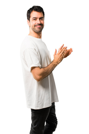 Young man with white shirt applauding after presentation in a conference on isolated white background Stock Photo