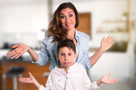 Mother and daughter having doubts and with confuse face expression inside house Reklamní fotografie