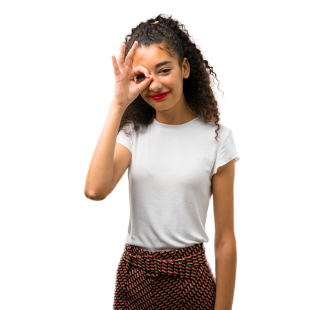 Young girl with curly hair makes funny and crazy face emotion on white background Stock fotó