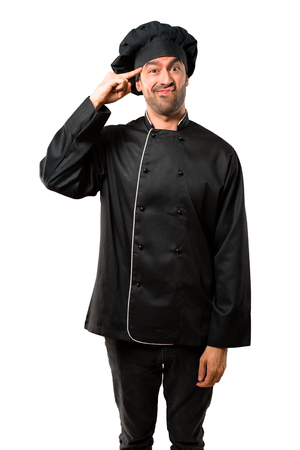 Chef man In black uniform making the gesture of madness putting finger on the head on isolated white background
