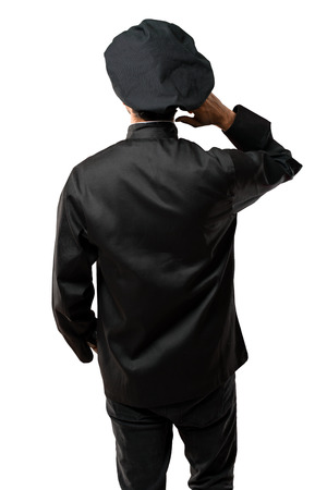 Chef man In black uniform on back position looking back while scratching head on isolated white background