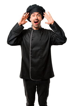 Chef man In black uniform with surprise and shocked facial expression. Gaping because can not believe what is happening on isolated white background