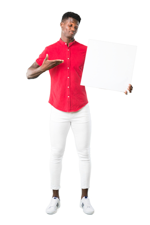 Full body of Young african american man holding an empty white placard for insert a concept on white background