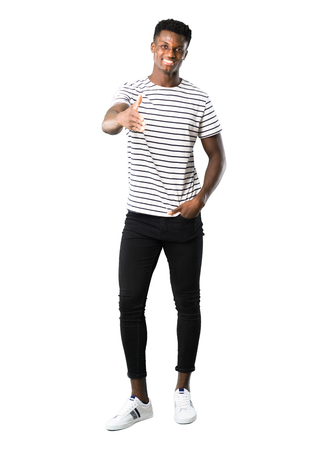 Full body of Dark skinned man with striped shirt shaking hands for closing a good deal on white background
