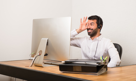 Telemarketer man in a office makes funny and crazy face emotion