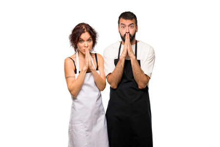 Couple of cooks keeps palm together. Person asks for something on isolated white background Banque d'images - 111487285