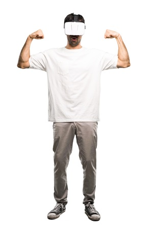 A full-length shot of a Man using VR glasses making strong gesture on isolated white background