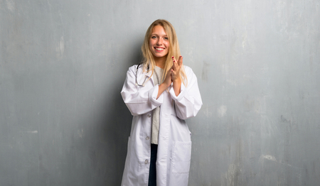 Young doctor woman applauding after presentation in a conference