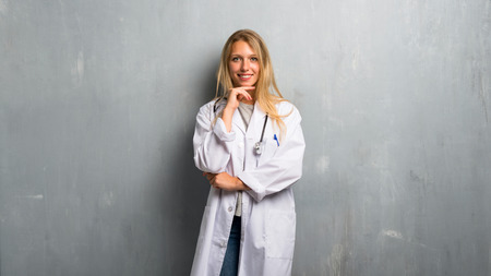 Young doctor woman smiling and looking to the front with confident face
