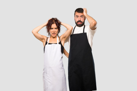 Couple of cooks takes hands on head because has migraine on grey background Imagens - 112446191
