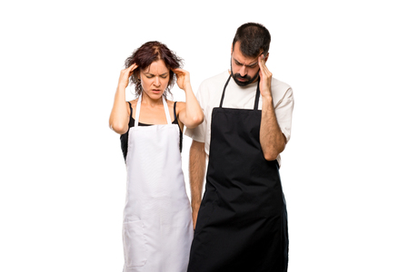 Couple of cooks unhappy with something. Negative facial expression on isolated white background 스톡 콘텐츠