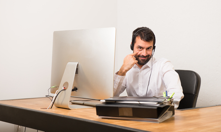 Telemarketer man in a office looking to the front