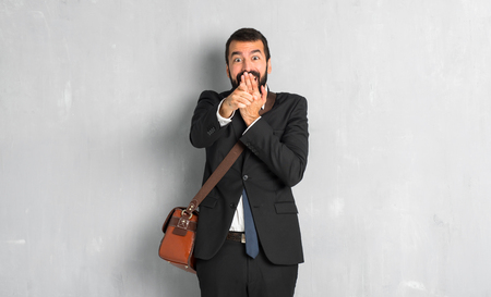 Businessman with beard pointing with finger at someone and laughing
