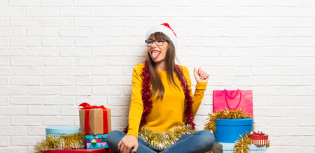 Girl celebrating the christmas holidays makes funny and crazy face emotion