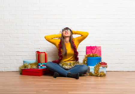 Girl celebrating the christmas holidays unhappy and frustrated with something. Negative facial expression Stock Photo