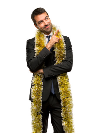 Man with champagne celebrating new year 2019 pointing a great idea and looking up on isolated white background