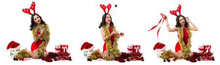 Pretty young woman with christmas balls and reindeer antlers