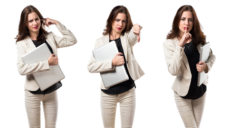 Pretty young business woman with laptop and making bad signal Banque d'images