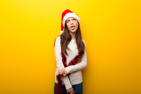 Teenager girl celebrating christmas holidays makes funny and crazy face emotion