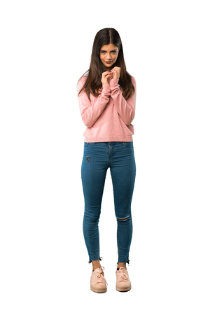 A full-length shot of a Teenager girl with pink shirt scheming something