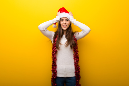Teenager girl celebrating christmas holidays unhappy and frustrated with something. Negative facial expression