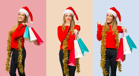 Set of Blonde woman dressed up for christmas holidays surprised while holding a lot of shopping bags Stockfoto