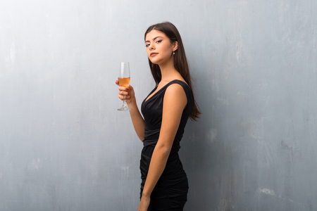 Teenager girl with champagne celebrating new year 2019 Stock Photo