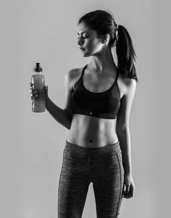 Young sport girl with a bottle Stock Photo