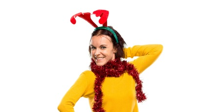 Happy girl dressed up for the christmas holidays on isolated background Banco de Imagens