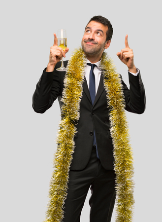 Man with champagne celebrating new year 2019 pointing with the index finger a great idea on isolated grey background