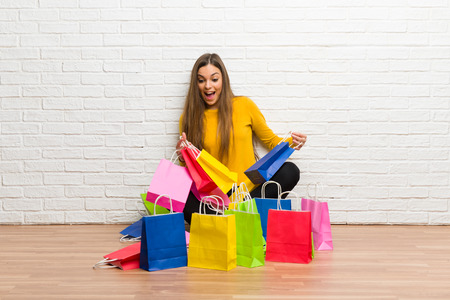 Young girl with lot of shopping bags Stock Photo