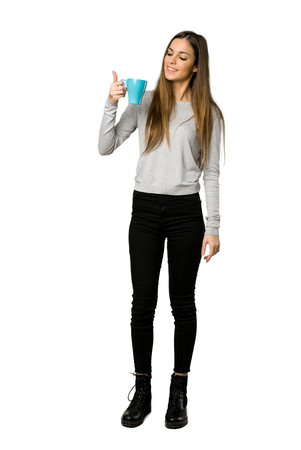 Full-length shot of young girl holding a hot cup of coffee on isolated white background