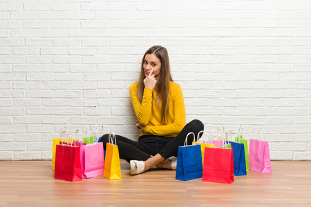 Young girl with lot of shopping bags looking to the front Stock Photo