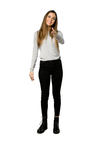 Full-length shot of young girl shaking hands for closing a good deal on isolated white background Stock Photo
