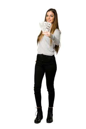 Full-length shot of young girl taking a lot of money on isolated white background