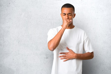 Young african american man is suffering with cough and feeling bad