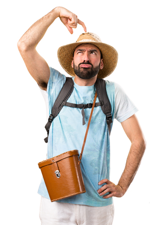 Funny tourist having doubts on isolated white background Stock Photo