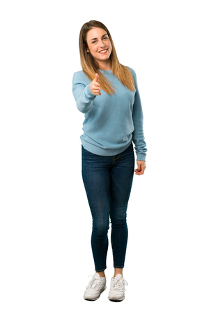 Full body of Blonde woman with blue shirt shaking hands for closing a good deal on white background Фото со стока