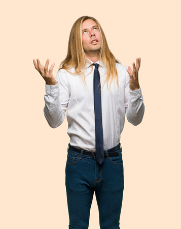 Blond businessman with long hair frustrated by a bad situation on isolated background