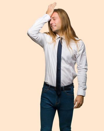 Blond businessman with long hair has just realized something and has intending the solution on isolated background