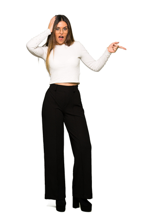 Full body of Pretty woman with glasses pointing finger to the side and presenting a product Foto de archivo