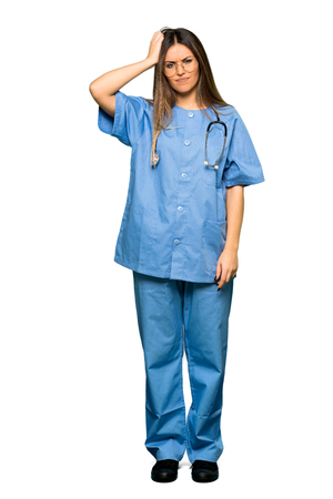 Full body of Young nurse with an expression of frustration and not understanding