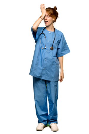 A full-length shot of a Young redhead nurse has just realized something and has intending the solution over isolated white background