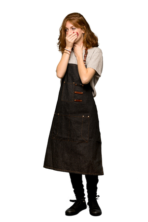 A full-length shot of a Young redhead woman with apron is suffering with cough and feeling bad over isolated white background Stock Photo