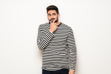 handsome man with striped shirt smiling and looking to the front with confident face Stock Photo