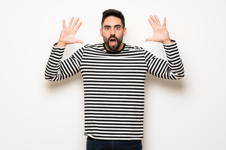 handsome man with striped shirt with surprise and shocked facial expression