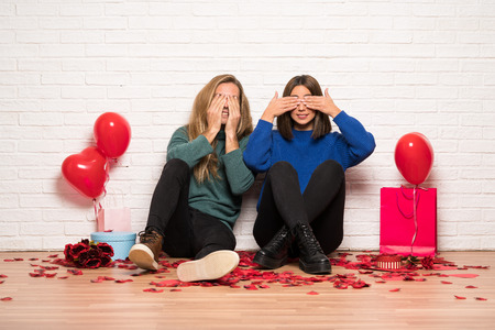 Couple in valentine day covering eyes by hands Stock Photo