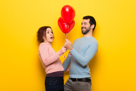 Couple in valentine day with balloons with heart shape Standard-Bild
