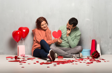 Couple in valentine day holding a heart symbol