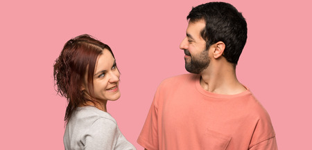 Couple in valentine day with happy expression over isolated pink background Stock Photo